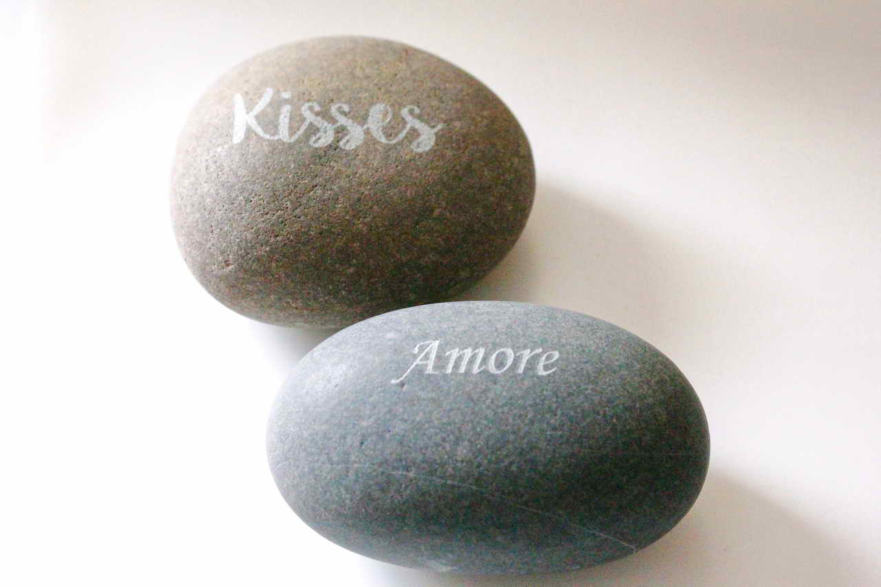 Laser etching kisses and amore on stone