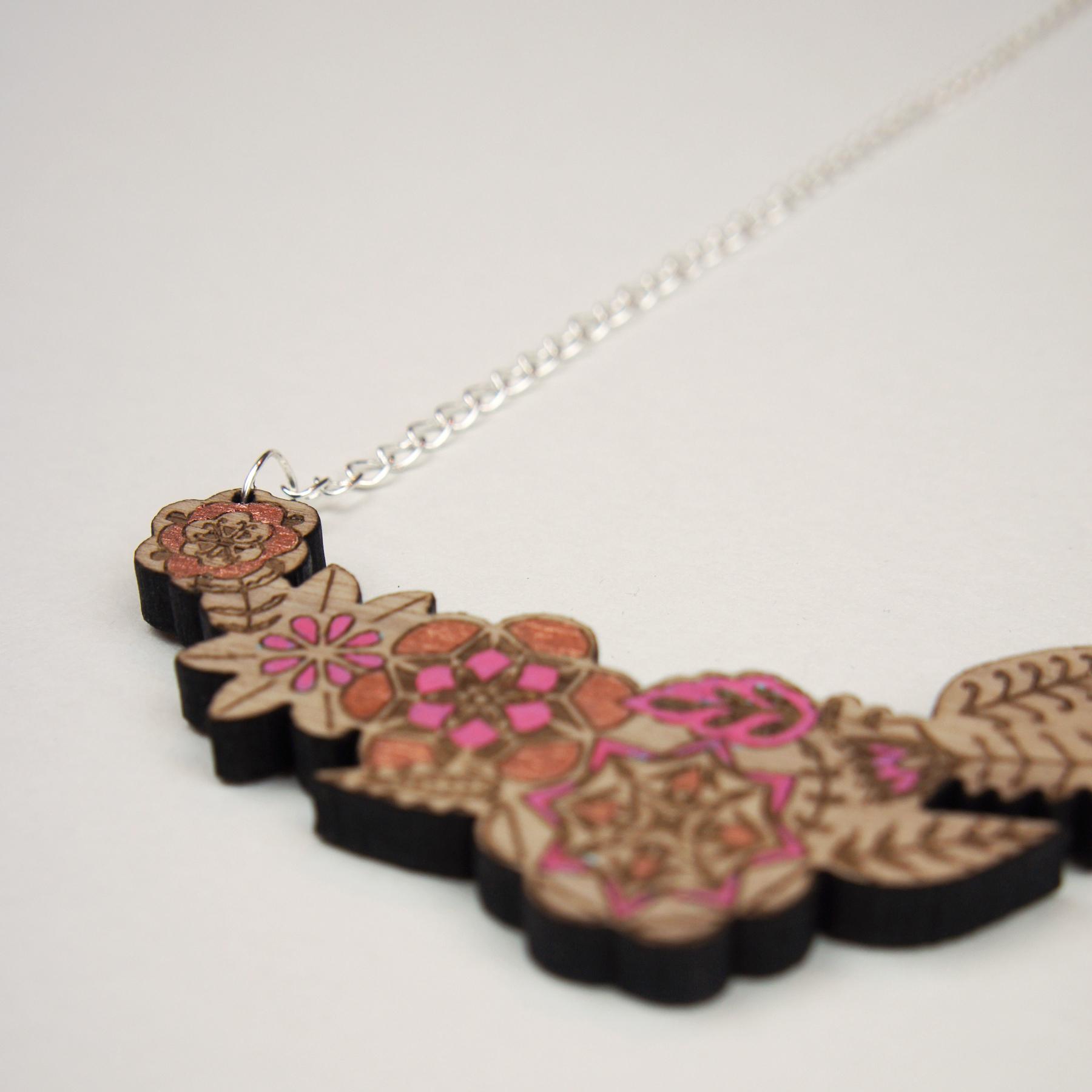 Close up of walnut flower necklace